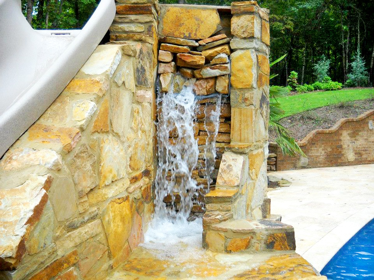 Law Pools & Patio Mediterranean Midnight Freestyle Pool – Slide & Natural Stone Waterfall (