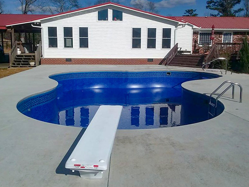 Law Pools & Patio custom lagoon with diving board