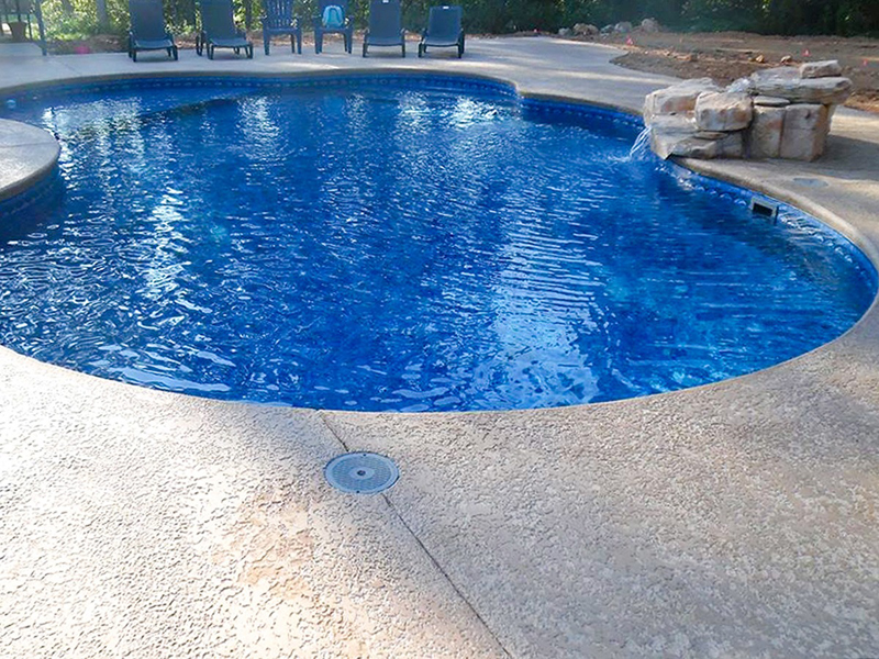 Law Pools & Patio lagoon pool with rock waterfall