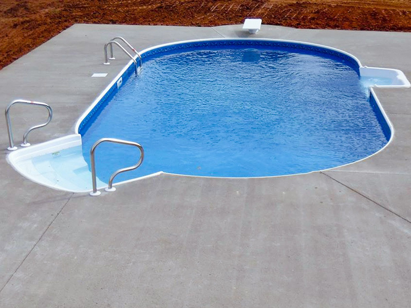 Law Pools & Patio simple oval pool with sitting area