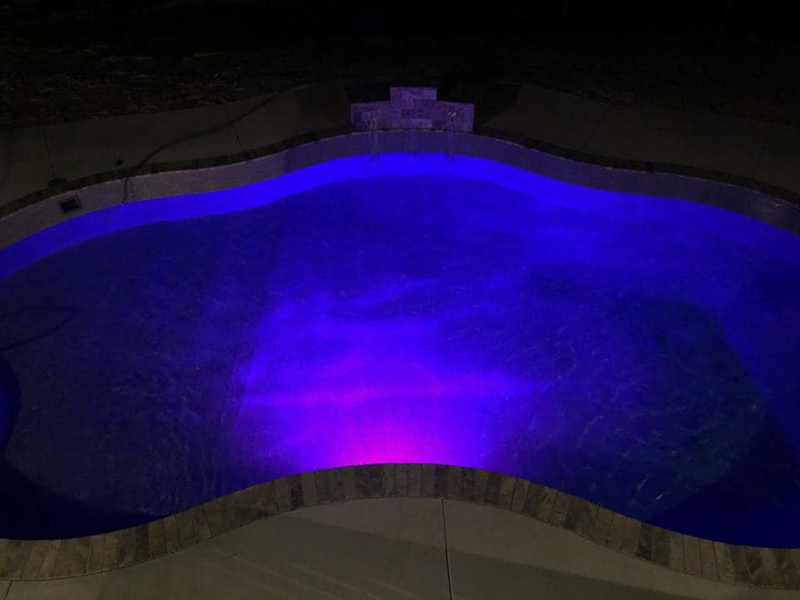 Law Pools & Patio waterfall feature with lighting