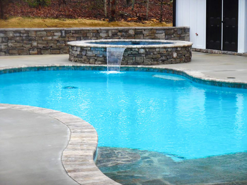 Law Pools & Patio spill over spa and pool