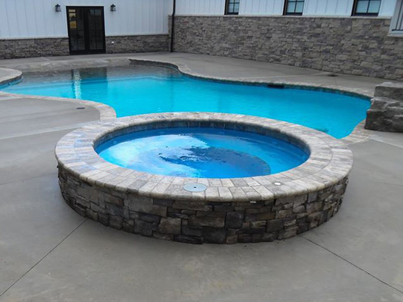 Law Pools & Patio beach walk in pool with spill over spa