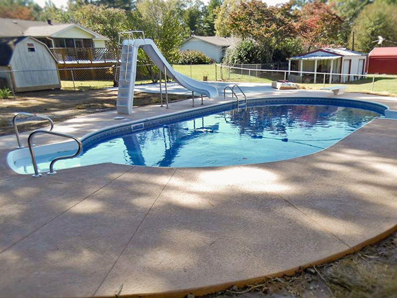 Law Pools & Patio pool with slide, diving board and seating area
