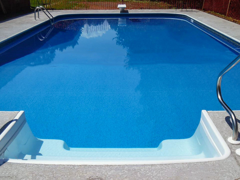 Law Pools & Patio rectangular pool with diving board