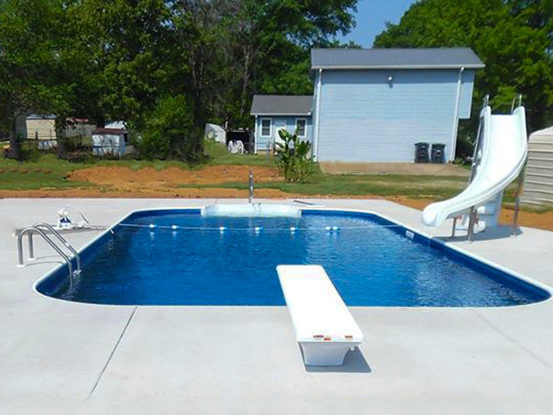 Law Pools & Patio pool with diving board and slide