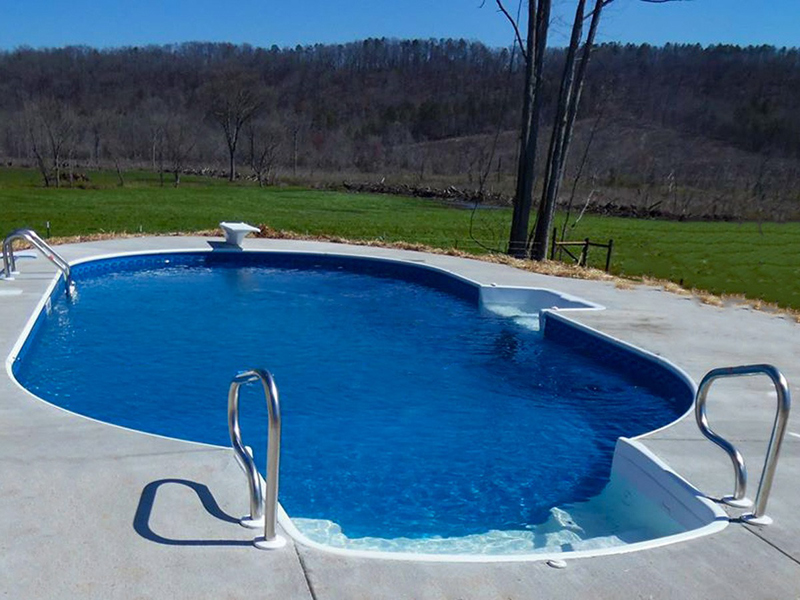 Law Pools & Patio pool with diving board and seating area