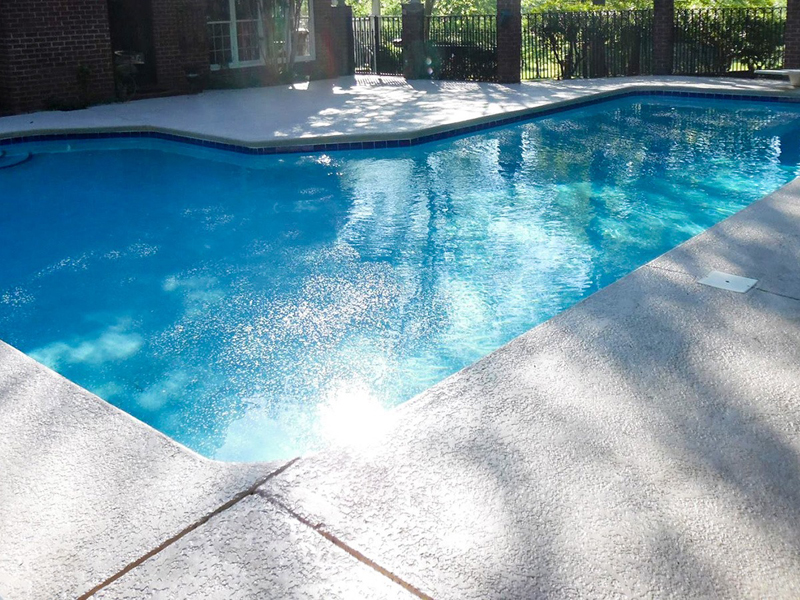 Law Pools & Patio l chaped pool