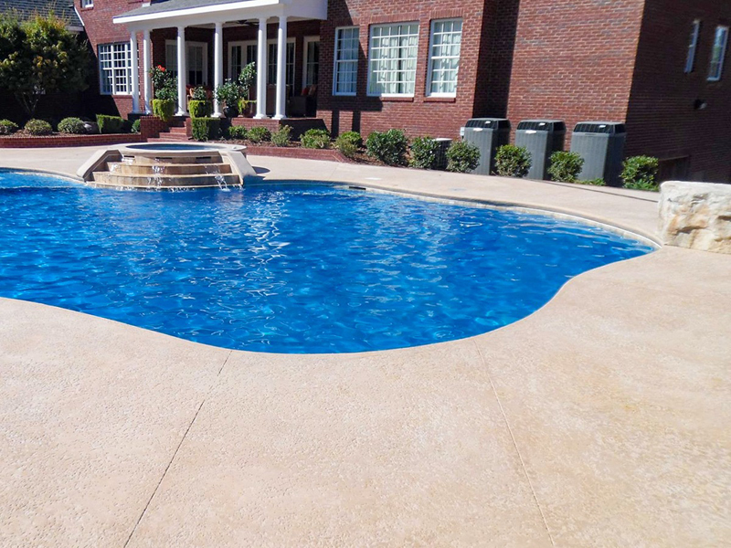 Law Pools & Patio pool with spill over spa, jets and fountains