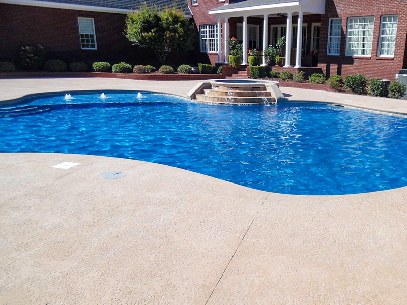 Law Pools & Patio oasis pool with fountains and spill over spa