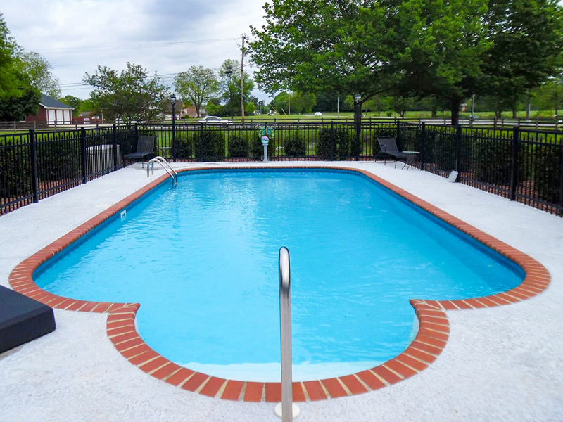 Law Pools & Patio custom backyard pool with walk in entrance
