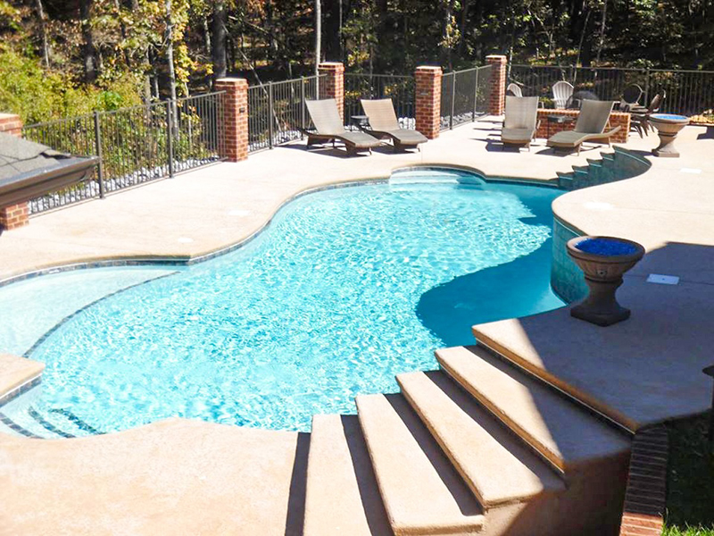 Law Pools & Patio custom lagoon pool with sitting areas and multiple entries