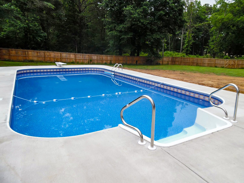 Law Pools & Patio pool with diving board and walk in area