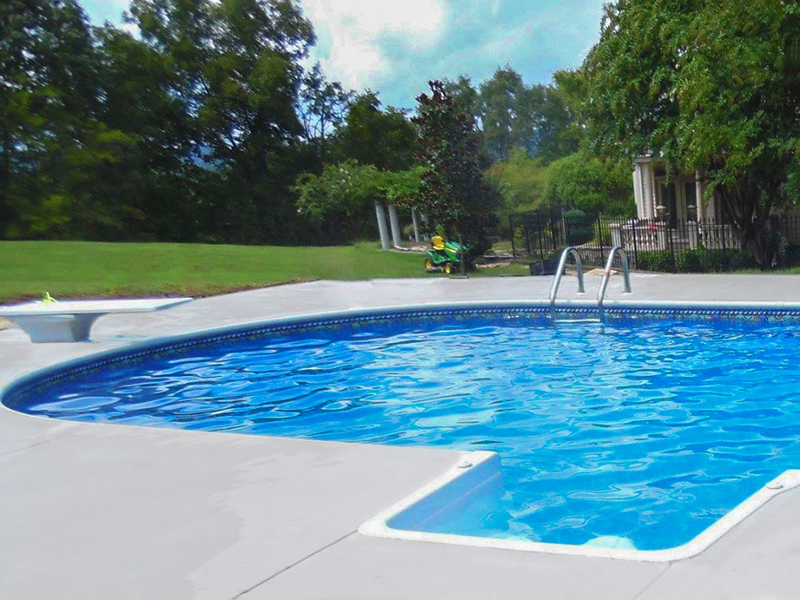 Law Pools & Patio pool with diving board