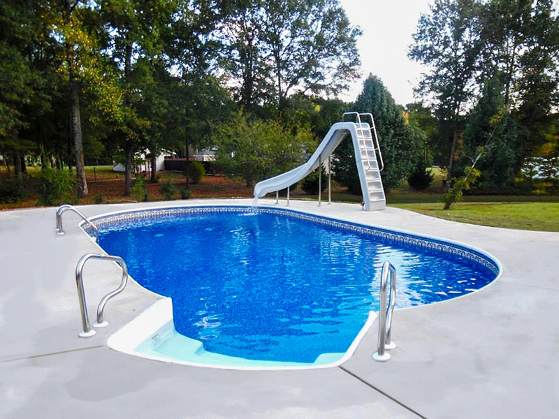 Law Pools & Patio oval pool with slide