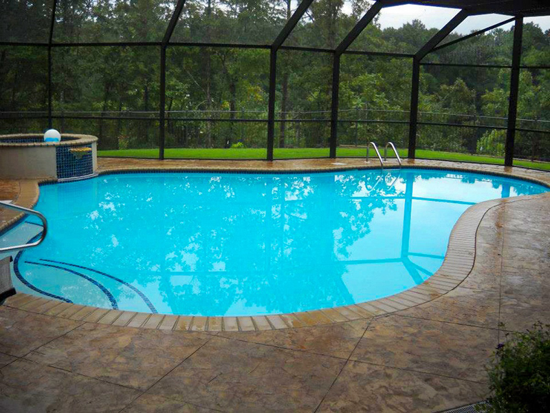 Law Pools & Patio indoor room pool with spa