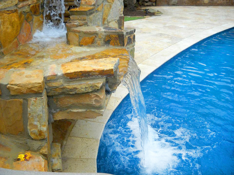 Law Pools & Patio Mediterranean Midnight Freestyle Pool – Patio, Slide, & Natural Stone Waterfall